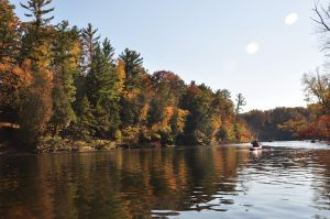 Kayakers on river in the fall