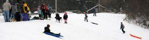 Kids sledding in winter