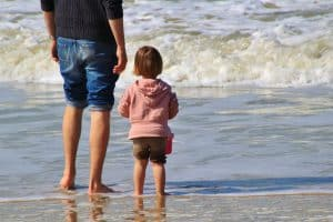 Parent and child at beach