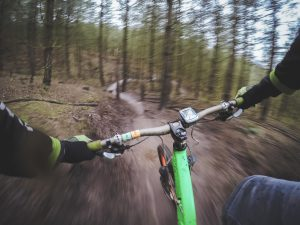 Handlebars of mountain bike on trail