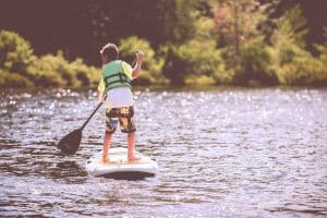 Young boy on stand up paddle board