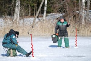 Men with augers on frozen lake