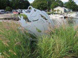 Metal fish sculpture in grass
