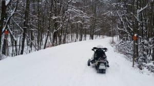 Snowmobile on trail