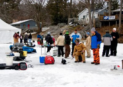 People ice fishing at D2D