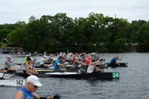 Power Paddle rowers in canoes racing
