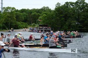 Power Paddle rowers in canoes