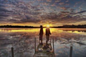 fishermen on dock at sunset