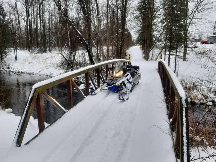 snowmobile on bridge